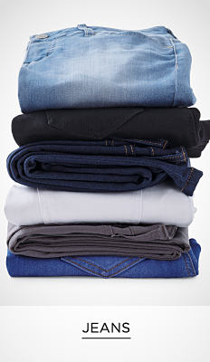 A stack of folded jeans in a variety of colors & styles. Jeans. Shop now.