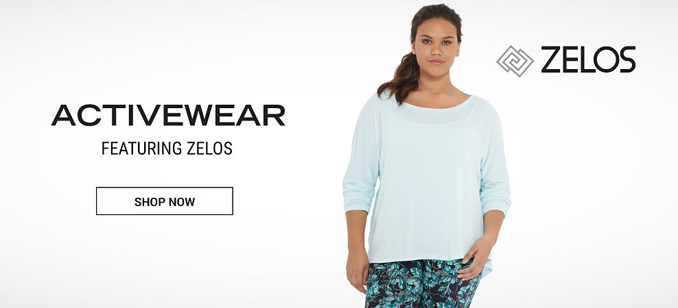 A woman wearing a light blue top & black & blue workout pants. Activewear featuring Zelos. Shop now.