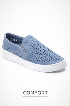 A blue slip-on sneaker with cutout detail. Comfort. Shop now.