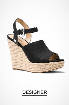 A black velvet strappy sandal with a chunky heel. Designer. Shop now.