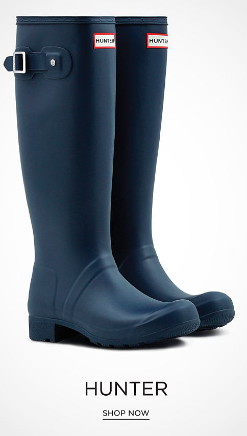 A pair of navy tall rain boots. Hunter. Shop now.