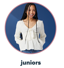 A young woman in an ivory smocked bottom top. Juniors.