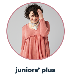 A young woman in a warm spice mixed fabric tunic. Juniors' plus.