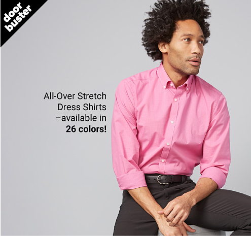 A man in a pink button front dress shirt and dark gray pants. Doorbuster. Men's wardrobe sale from 20.99 with coupon men's dress shirts featuring IZOD. All over stretch dress shirts, available in 26 colors. Shop event. Shop dress shirts.