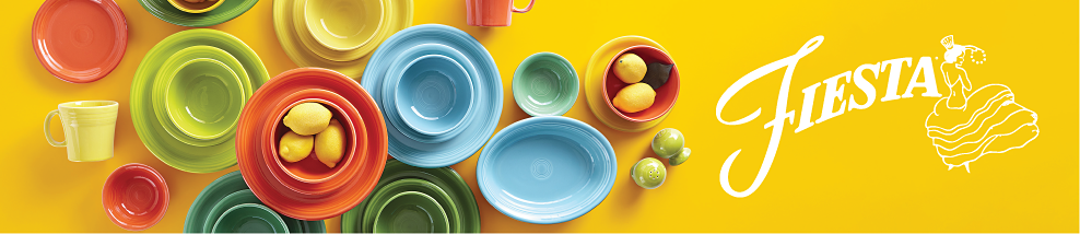 An assortment of dinnerware in a variety of bright colors. Fiesta