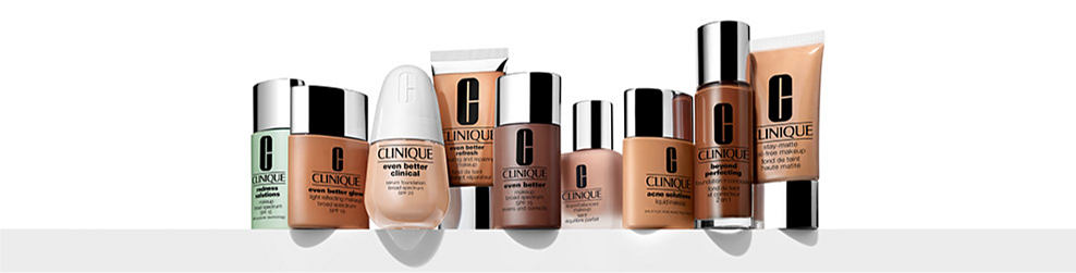 A row of bottles of Clinique beauty products in a variety of colors, prints and styles.