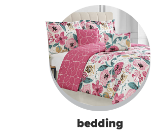 A pink, white and green floral bedspread. Bedding.
