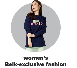 A woman wearing a blue shirt reading sunkissed. Women's Belk exclusive fashion.