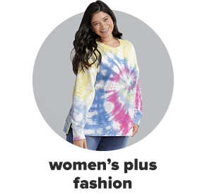 A woman in a long sleeve top in pink, blue and yellow tie dye. Women's plus fashion.
