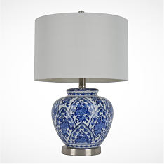 A blue and white table lamp with a white lamp shade. Shop lamps & lighting.