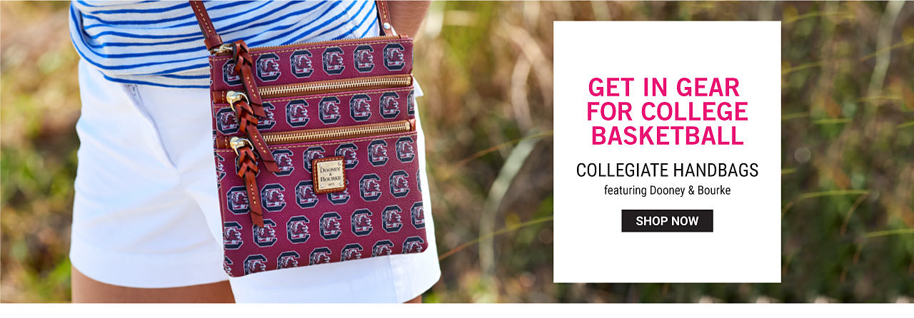 A woman wearing a blue & white horizontal striped top & white shorts carrying a University of South Carolina Gamecocks logo print handbag. Get in Gear for College Basketball. Collegiate handbags featuring Dooney & Bourke. Shop now.