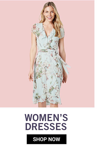 A woman wearing a multi colored floral print sleeveless dress. Women's dresses. Shop now.