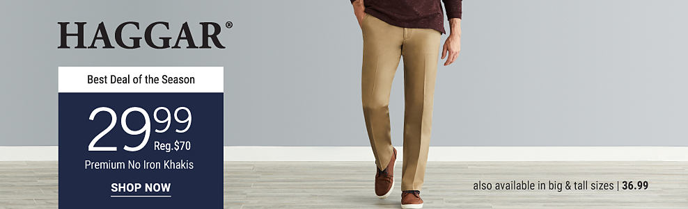 A man wearing a burgundy polo. beige pants & brown sneakers. From $29.99 Haggar premium no iron khakis. Regularly price at $70. Also available in big & tall sizes from $36.999. Shop now.