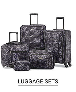 A black luggage set with an assortment of spinner bags in a variety of sizes and carry-on bags. Shop luggage sets.