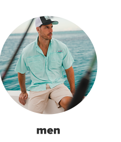 A man in a black and white trucker hat, a teal button down and khaki shorts. Men.