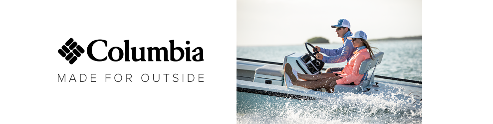 Columbia. Made for outside. A man and a woman in a white speedboat. The man in a long sleeve blue shirt, a blue and white trucker hat and gray shorts. The woman in a peach jacket, a white hat, navy shorts and white sneakers.