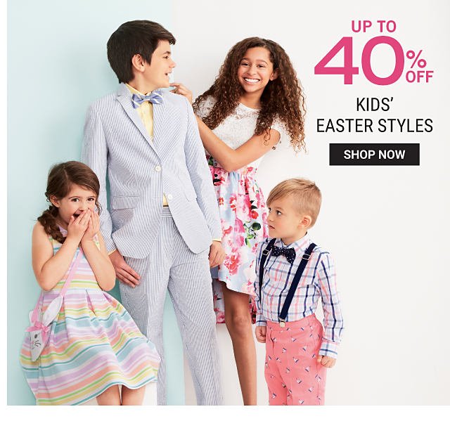 A girl wearing a multi colored horizontal striped sleeveless dress. A boy wearing a lavender suit, a yellow dress shirt & a blue & white bow tie. A girl wearing a multi colored floral print short sleeved dress. A boy wearing a blue, pink & white check dress shirt, navy suspenders, a navy bow tie & coral pants. Up to 40% off kids Easter styles. Shop now.
