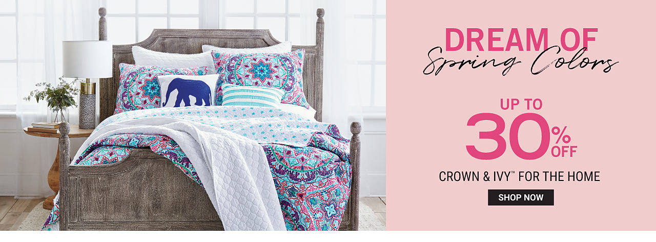 A bed made with a multi colored print quilt & matching pillows. Dream of Spring Colors. Up to 30% off Crown & Ivy for the Home. Shop now.