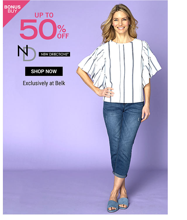 A woman wearing a white short sleeved top with multi colored vertical stripes, blue jeans & blue sandals. Bonus Buy. Up to 50% off New Directions. Exclusively at Belk. Shop now.