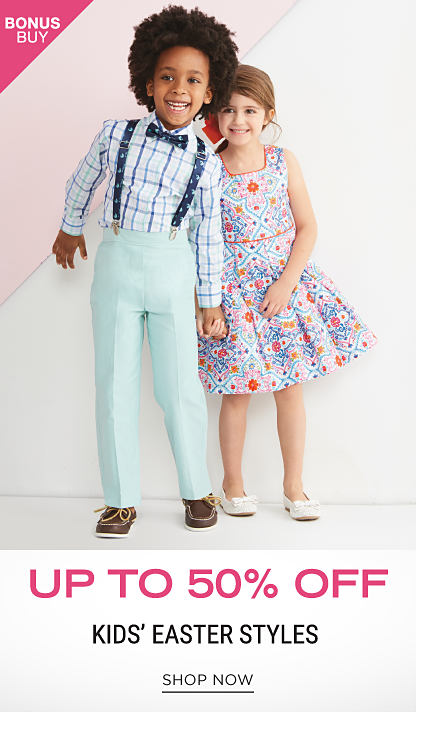 A boy wearing a white dress shirt with a mult colored grid pattern, light teal pants, navy suspenders, a navy bow tie & brown deck shoes standing next to a girl wearing a red, blue & white print sleeveless dress. Bonus Buy. Up to 50% off kids' Easter styles. Shop now.