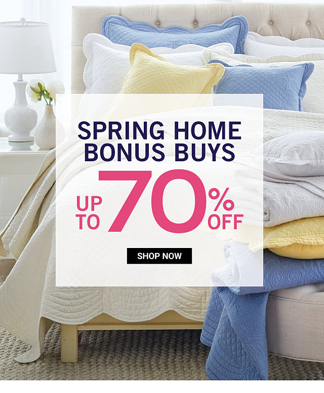 A bed made with a white quilt, a variety of different colored pillows with a different colored blankets at the foot of the bed. Spring Home Bonus Buys. Up to 70% off. Shop now.
