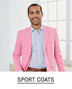 A man wearing a pink sport coat & a gray dress shirt. Shop sport coats.