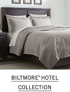A bed with beige and cream bedding and pillows to match. Shop Biltmore Hotel Collection.