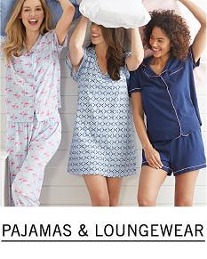 Three women wearing various colors & styles of pajamas. Shop pajamas & loungewear.
