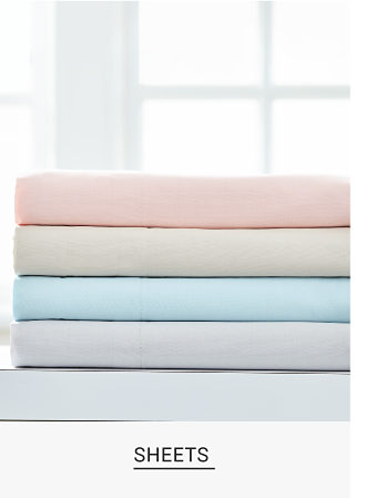 A stack of brightly colored sheets. Sheets. Shop now.