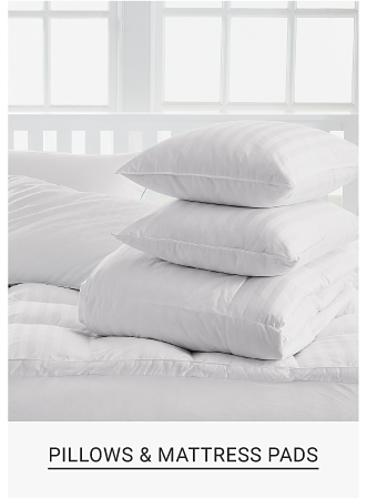 A stack of white pillows. Pillows and mattress pads. Shop now.
