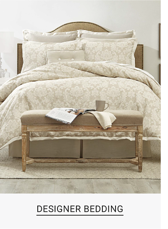 A bed made up in a beige comforter with matching pillows. Shop now.