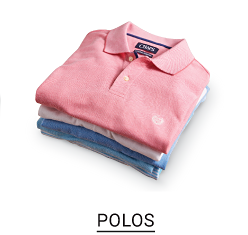 Colorful polo shirts stacked in one pile. Shop Polos.