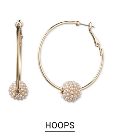 A pair of hoop earrings with a charm with small pearls. Shop hoops.