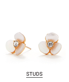 A pair of flower stud earrings with a small diamond. Shop studs.