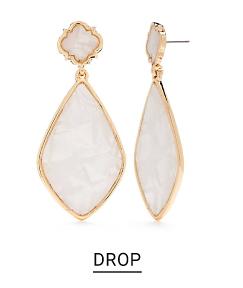 A pair of white teardrop earrings trimmed in gold. Shop drop.