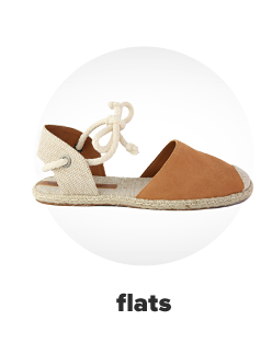 An espadrille sandal with a brown toe, off white heel and a tie accent. Flats.