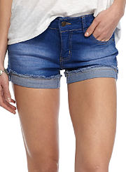 A young woman wearing a pair of denim shorts. Shop shorts.
