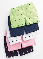 An assortment of shorts with embroidered flamingos, pineapples and more. Shop shorts.