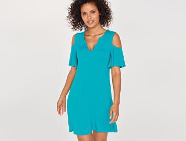 A woman wearing a teal dress.