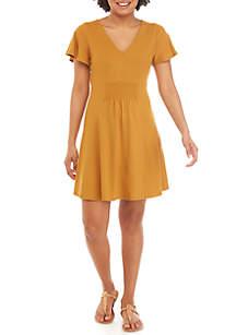 love, Fire Short Flutter Sleeve Smocked Dress