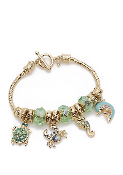 Napier Boxed Gold Tone Sea Life Charm Bracelet
