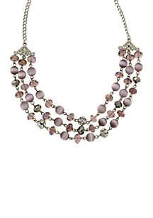 1928 Jewelry Silver Tone Purple Cats Eye 3 Row Necklace