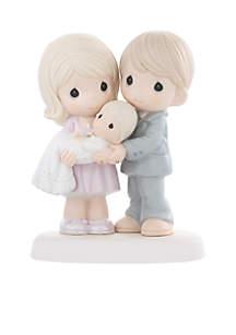 Parents Holding Baby Figurine